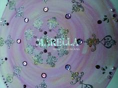 Mandala em aquarela em tons de rosa e dourado.Diâmetro médio de 25cm. Moldura branca padrão. *Pode haver divergência na tonalidade.