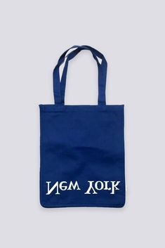 Inverted New York and Los Angeles logo tote. Features two top handles and a soft cotton material. - Cotton- Made in USA- Length: / Depth: / Height: / Strap drop: Los Angeles Logo, Cotton Logo, Women's Accessories, Product Launch, Reusable Tote Bags, Blue, Wallets, Drop, Women Accessories