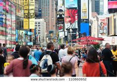 NEW YORK CITY - JUNE 28: Times Square is a busy tourist intersection of commerce Advertisements and a famous street of New York City and US, seen on June 28, 2012 in New York, NY. by pio3, via ShutterStock