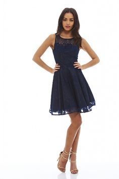 Stand out from the crowd in this navy lace skater dress! This sleeveless style with its high neck and mini length will accentuate your waist and show off your pins. Simply pair with some heels for a look all your friends will envy!