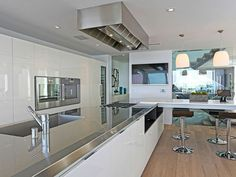 gorgeous stainless steel kitchen in a Los Angeles Penthouse