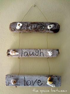 Motto zum Aufhängen aus Treibholz und Muscheln