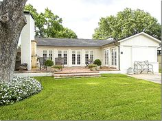 small house has an extra room with a large patio and outdoor fireplace; LOVE the rows and rows of french doors