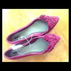 Pointed Toe Flats Cranberry color with rosette details. Suede. Cushioned footbed. Never worn. Mossimo Shoes Flats & Loafers