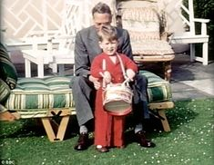 Little drummer boy: The Prince hammers away on his favourite toy with his grandfather, King George VI