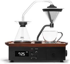 The 5 Quirkiest Coffee Gadgets - Daily Espresso Coffee Cups, Coffee Maker, Coffee Coffee, Filter Coffee Machine, Walnut Timber, Milk Shop, Premium Coffee, Coffee Drawing, Cafetiere