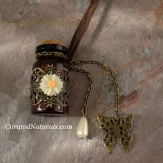 Essential Oil Vial Necklace 5 ML glass amber bottle Holds 5 ML of liquid Long leather necklace can be retied to shorten beautiful butterfly and faux pearl accen