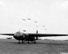 C-47's fly Over a British built Horsa Glider which they have dropped during manoeuvres in Berkshire, England. 6 January 1944