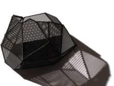 Joanne Huang - 'Cover & Discover' Series. Brooch. PVC mesh sheet, silk, silver. Photo courtecy of the artist.