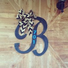 Black distressed wooden B with chevron burlap bow!! Made to order, search Facebook for Bailey Creation in columbia, ky