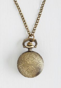 Today's Timeline Necklace in Bronze. Keep your schedule in style by clasping this long pocket-watch necklace over your ensemble! #gold #modcloth