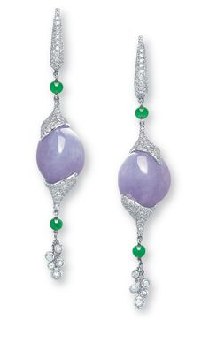 CHRISTIE'S - A PAIR OF JADEITE AND DIAMOND EAR PENDANTS.  Each suspending a freeform jadeite pendant of rich lavender colour and very good translucency, terminated at both ends with pavé-set diamond caps, enhanced by diamond tassels and green jadeite beads, to the diamond-set surmount, mounted in 18k white gold, 7.2 cm long. Certified natural jadeite, no polymers detected. Price realised (SALE 2918 — HONG KONG MAGNIFICENT JEWELS May 2012): $22,650