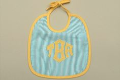 Seersucker monogrammed bib...love it! When I have children they will be exceptionally well dressed