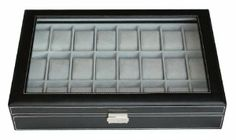 "Elegant 24 Piece Black Leatherette Watch Display Case and Storage Organizer Box by TIMELYBUYS. $59.99. Case measures 11.25"" L x 17"" W x 3"" H; Each compartment measures 45 mm in width (3.25"" L x 1.75"" W). Secure your collection with our elegant lock and key. Detailed white stitching and attractive faux suede lining add a luxury feel. Tastefully protects, stores, and organizes up to 24 watches. Removable pillows make room for other accessories. Store up to 24 of you..."