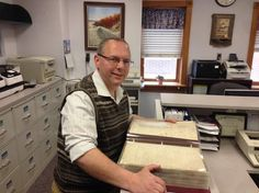 North Wildwood City Clerk Scott Jett is shown with the minutes from the Borough of Anglesea meetings from 1885 to about 1890, including the minutes of the first borough meeting, held Jan. 3, 1885.