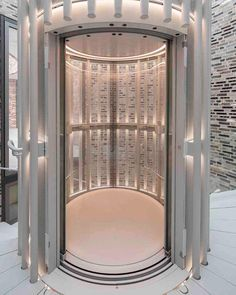 Eliasson celebrates level transition with a both high and low tech features. A circular elevator features futuristic top and bottom lighting along with 'splayed armatures' that sits within the surrounding brick stairwell.