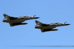 French Armée de l'Air Ramex Delta pair of Dassault Mirage 2000Ns are regulars at air shows since they are found in the four corners of France throughout the summer. Here displaying 6/7 June 2015, for the 100th anniversary of Base 705 Tours and Parcay aviation camp.