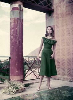 Model standing on terrace of the Chinese Palace (Palazzina Cinese) in the park La Favorita (Palermo) wearing green linen close-bodied, soft-bosomed dress. [photo by Henry Clarke, ca. 1955]