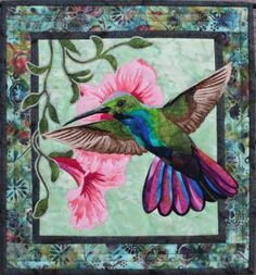 This Hummingbird Applique Quilt Pattern by Toni Whitney Design features an in-flight hummingbird poised to get nectar from pink flowers hanging on a vine.  The pattern is designed for raw edge fusible applique, so I recommend that you use an Applique Pressing Sheet.  The pattern contains easy to follow instructions, a full size layout guide, and pattern pieces that are already reversed for applique. Included is a suggested color swatch strip to aid in fabric selection.