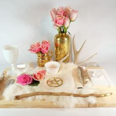 Full moon altar! Gold, pink roses, fur.