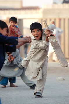 Boys playing cricket in Pakistan