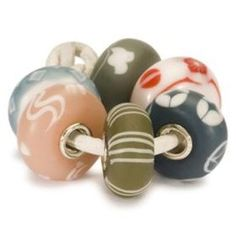 Trollbeads is thrilled to announce the launch of the Limited Edition Kimono Kit. The delicate collection of six beads in matte colors was created by Japanese designer Nozomi Kaji. This very limited collection is made from Japanese glass and is inspired by the colors and patterns of a Japanese silk kimono. The structure of the Japanese raw glass introduces a new look that is vastly different from the glass beads in the existing collection.