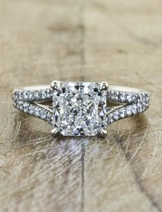 ohh, i like this one! maybe just take away all the small diamonds on the band, and have just the princess cut diamond in the center, with just the simple dual bands