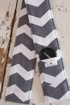 DSLR Camera Strap Cover- lens cap pocket and padding included- Grey and White Chevron. $14.00, via Etsy.