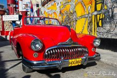 Theres always a way if youre not in a hurry.  Paul Theroux ... Sharing a little warmth sunshine and bright colors from the graffiti art district of Callejón de Hamel Havana. My friends and I were chauffeured around in this classic candy apple red Buick on a beautiful day in Cuba. ................................... . . . . .  #instapassport #thecreative #artofvisuals #aroundtheworldpix #ig_masterpiece #theprettycities #flashesofdelight #travelog #mytinyatlas #visualmobs #theglobewanderer…