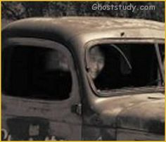 """Officer captures ghost! """"I work in law enforcement, but I am an amateur photographer for a hobby. I was taking a picture of an old truck in Chico, California. I swear that I saw nobody inside of this truck when I took this picture. I even walked right up to it. Later when I downloaded the picture onto my computer, I looked closer at what I thought was part of the rear window and it is clearly a face (close-up above, full image below). It appears to be looking right at me when I took this."""""""