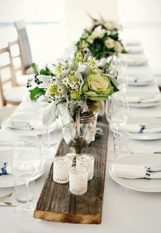 Use a piece of reclaimed wood as a beautiful, simple centerpiece.