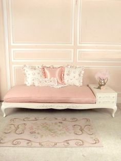 Pink and White Daybed with Attached Side Table