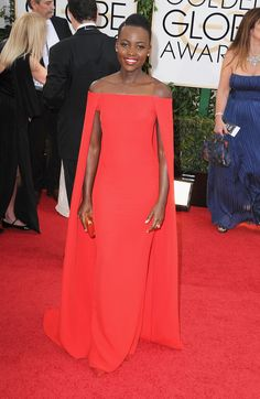 Lupita is stunning in her red cape gown.