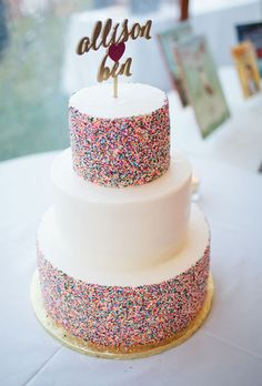 Brides.com: . A personalized, gold-hued cake topper and hundreds of nonpareils make this dessert by Trillium Caterers extra sweet!
