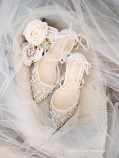 """- Florence - 'Enchanted' bridal collection - Hand beaded with milky teardrop stones and beads - Cross ankle straps - Lovely tied bow at heel cups - Intricate and luxurious - Ivory - 3 3/4"""" inch heels - Handmade - Imported mesh and silk upper - Imported leather sole - Heavy padding for all-day comfort - Sizing runs true to size"""