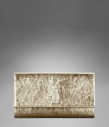 (YSL clutch in metallic gold}  . . . timeless appeal.