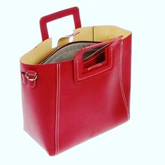 Why Carry A Black Tote This Winter When The Season S Colour Is Red From And Under Ideal For Ng Punch Against Usual Long Coat