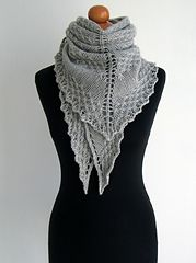 A fairly simple, yet effective shawl, in triangle shape, worked from center outwards, featuring a lacy stitch that creates nice texture.