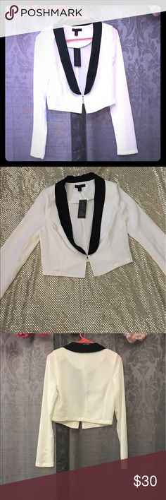 """NWT White and Black Stretch Blazer Brand new with tags never worn. The more you bundle the better deal I can give you. Just comment for any kind of help I am here for you! I strive for quality items at the best price. I consider offers, am a fast shopper, & top rated seller. This is for the top only, the items paired may be available in my boutique. One shoulder pad in each shoulder for shape and stretchy material! It is about 17"""" long. Material Girl Jackets & Coats Blazers"""