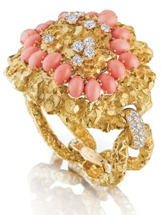This unique gold, coral, and diamond bracelet is 1950's Mauboussin- what do you think of its chunky retro style?  (Via Phillips.)
