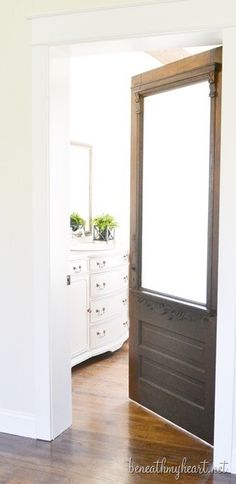 An old door added to a new home reno - wonderful touch! House Tour | Beneath My Heart