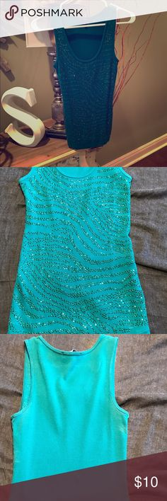 🌟Express Jeweled Ribbed Tank Top🌟 Gorgeous green ribbed tank top coved in tiny green rhinestones. Size small. Gently used. Express Tops Tank Tops