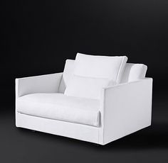 RH's Kristoffer Fabric Chair-and-a-Half:Sleek geometry meets sink-in comfort in our Danish-inspired design. Slender arms set off wider seat proportions, while recessed feet give it the appearance of floating off the ground. Amply padded cushions and pillows invite hours of lingering.
