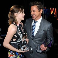 Emma Watson and Robert Downey Jr. Lol why is he always making weird faces!?