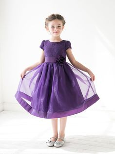 This look is pure preciousness. The full tea length skirt with underneath netting will make her feel like the doll she is. The beautiful lace bodice paired with delicate cap sleeves offers a classic t