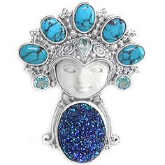 """This sweet pin-pendant measures 1 3/4"""" and packs a lot of gems in that space! Five 5x7mm Turquoise ovals perch atop our Goddesses head while two 4mm Apatite complete the halo. A single 3x5mm faceted Aquamarine pear is featured on her headdress and her body is formed by a 12x16mm druzy. This fascinating goddess pin-pendant was designed by Marianna and Richard and handcrafted by Balinese Artisans."""