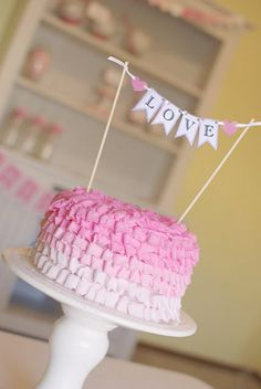 Love these ruffle cakes.  Instead of love on the banner, have a different color for each girl and their name or monogram.