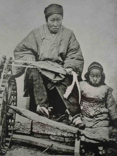 China. Spinning woman and child. Note multiple spindles