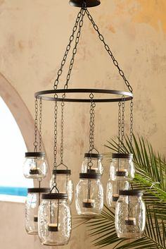 We usually associate chandeliers with extravagance or opulence, but Pier 1's Mason Jar Hanging Chandelier puts a practical twist on the concept. Eight colorful Mason jars are suspended from metal chains for a rustic look that will charm your outdoor hangout. Think front porch, backyard or pool area.