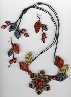 This micromacre necklace set is made with lovely earthy colors, rust, pale gold, black, and blue grey. This set goes great with jeans but can be dressed up or down, depending on the occasion. It is a sure winner for the fall season, but these colors look good all year long! Thanks to the sliding closure, you can adjust the necklace to wear short or long. Matching earrings are approximately 2 1/2 long from earwire and pendant approximately 2-3 inches across. It takes lots and lots of tiny…